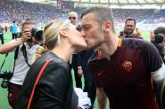 "ROME, ITALY - MAY 2016 : Totti kisses his wife ilary blasi after the  football match  of Italian League ""Serie A"" between A.s. Roma  vs Chievo at the Olimpic Stadium  on May 8, 2016 in Rome.